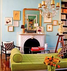 Green sofa with bolster.  Light blue walls.  I love this color combination.