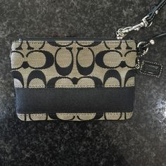 Coach wristlet Authentic black Coach wristlet. Barely used, great condition! Bags Clutches & Wristlets
