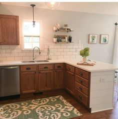 oak cabinets / white countertops & subway tile.