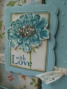 Field Flowers and SAB papers 2013; Silver glass glitter; Crochet ribbon; Designer Frames Embossing Folders (Retired 2014).
