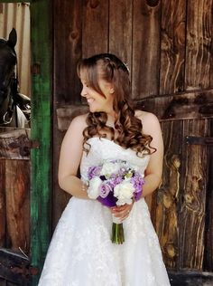 A beaming bride holds an elegant bouquet of peonies, roses, lisianthus, stock, and baby's breath. Wedding Flowers: Seasonal Celebrations.