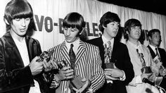 Jun 23, 1966: Munich, Germany; The BEATLES will perform in Munich, Essen and Hamburg. They will stay for two days at the Bayerischer Hof Hotel in Munich. The picture shows The Beatles during a press conference in Munich, holding each one a present from BRAVO, the 'Golden Otto' for the 'Best Band in the World'. (From L-R) GEORGE HARRISON, RINGO STARR, PAUL MAcCARTNEY and JOHN LENNON.