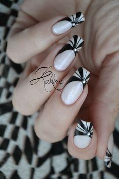 White Nails with Black Pinwheel Design.
