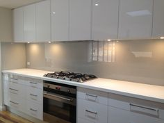 Ultimate Glass Splashbacks specialises in coloured glass splashbacks, kitchen splashbacks, glass tables, mirrors and more, located in Melbourne. Light Grey Kitchens, White Gloss Kitchen, Neutral Kitchen, Glass Backsplash Kitchen, Glass Kitchen, Kitchen Tiles, Kitchen Glass Splashbacks, Backsplash Cheap, Hexagon Backsplash