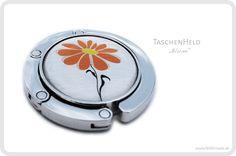 http://de.dawanda.com/product/97731683-taschenheld-taschenhalter-handtaschenhalter