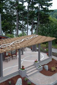 Beautiful Lake View Deck This simple L-shaped deck was transformed into a work of art by adding an inlaid Celtic pattern. The weave goes down both legs of the L with the knot design in the center...