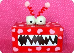 To make this cute Valentine's Day Box you will need the following supplies:  Empty Tissue Box Egg Carton Spray Paint White craft foam Foam hearts Pipe Cleaners Pom Poms  Googly Eyes Hot glue  1. Spray paint your tissue box red (or other desired color) 2. Once the box has dried add pink foam hearts.  I used the sticky kind, but you could also paint your hearts on as well. 3. Cut out two sections of the egg carton and spray paint (if it isn't already white), hot glue googly eyes on. 4. Cut out…