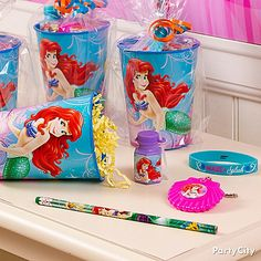Make fin-tastic favor cups with a reusable Little Mermaid plastic cup filled with treasures and slipped inside a clear bag with some ribbon. Click the pic for more Little Mermaid party ideas.