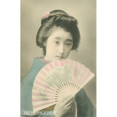 1910's. A young Japanese woman in kimono and traditional hairstyle is holding a sensu (folding fan). This postcard was published sometime between 1907 and 1918. During the early 20th century, picture postcards of bijin (beautiful women) were extremely popular in Japan