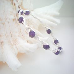 purple wire wrapped bangle bracelet by KimberlyAnnMarie on Etsy. $24.00, via Etsy.