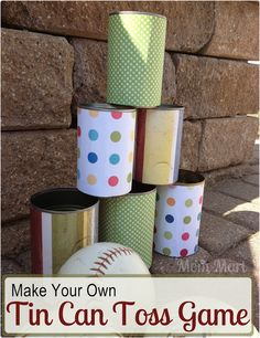 DIY TIN CAN TOSS GAME! Save your cans (clean them) and decorate with some wrapping or scrapbook or contact paper. Add some softballs and you're ready to play!