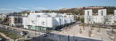 jean-pierre lott wraps vitrolles media library in france with rippling concrete façade
