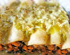 Sweet Potato Black Bean Enchiladas Recipe Main Dishes with vegetable broth, arrowroot starch, cold water, green chile, garlic, chili powder, black beans, garlic, lime, sweet potatoes, green chile, ground cumin, chili powder, black pepper, chopped cilantro fresh, vegetable oil, corn tortillas, shredded Monterey Jack cheese, vegan cheese