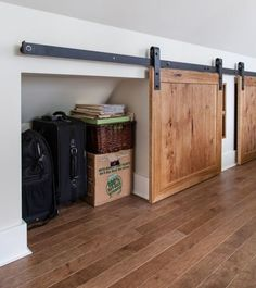 Have a small nook that you're not sure what to do with? Turn it into extra storage, hidden by a mini barn door.