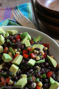 This Black Bean and Corn Salad couldn't be easier! With just a handful of ingredients, this delicious salad goes together in minutes! Perfect for parties, potlucks, tailgating, cookouts and more!
