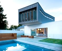 dimitty andersen architects floats curved extension over rose park residence