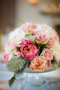 Flowers on cake stand, like the silver sage leaves - Garden Party