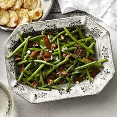 Swap-in this savory-sweet side dish for green bean casserole of years past. It's sure to stand out with bold ingredients like bacon and pecans.