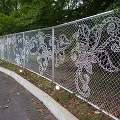 Reimagined space, turning an eyesore chain link fence into a lacey piece of outdoor art. This is yarn bombing at it's finest! Backyard Fences, Garden Fencing, Garden Art, Pool Fence, Bamboo Fencing, Fence Landscaping, Land Art, Muebles Shabby Chic, Chain Link Fence