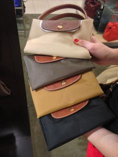 Longchamp size large. Love the tan, brown, and black.