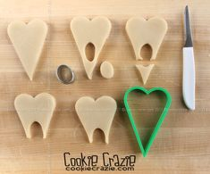 Tooth Decorated Cookies (Tutorial) — CookieCrazie Every time I go to the dentist, my dental hygienist and I talk about Dental Cake, Tooth Cake, Cookie Tutorials, First Tooth, Fondant Toppers, Dental Hygienist, Cookie Designs, How To Make Cookies, Making Cookies