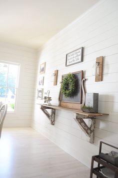 Farmhouse home tour - white shiplap dining room with corbel self and vintage chealkboard