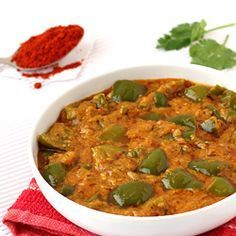 Capsicum Masala Curry 2 medium Green Capsicum (green bell peppers/shimla mirch) 2 teaspoons Coriander Seeds 1 tablespoon grated Dry Coconut 1 Dry Red Chilli 1 teaspoon Sesame Seeds 1/4 cup Roasted Peanuts 1/2 teaspoon Cumin Seeds (jeera) 1 medium Onion, finely chopped 2 cloves Garlic, crushed 1/2 teaspoon Red Chilli Powder (lal mirch) 1/4 teaspoon Turmeric Powder (haldi) 1/2 teaspoon Lemon Juice 1 teaspoon Sugar 2 tablespoons Cooking Oil Salt 3/4 cup Water