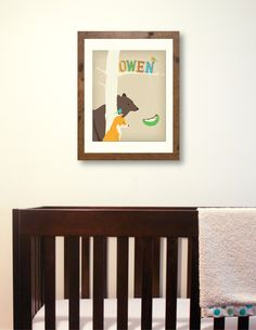 Personalized children's art features bear, fox, and bird peering at a newborn baby below your child's name. $28.00, via Etsy.