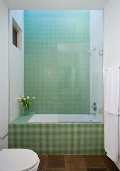 Green tile is trending in interior design. Here are 35 reasons why we can't get enough green tile. For more interior design trends and inspiration, visit domino. Bathroom Design Inspiration, Bad Inspiration, Design Ideas, Tub Shower Combo, Shower Tub, Glass Shower, Shower Faucet, Bathroom Renos, Bathroom Interior