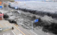 Japan earthquake and tsunami anniversary: crashing over a street in Miyako City.