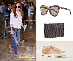 - Karen Walker: Number One Sunglasses in Crazy Tortoise - Goyard: Clutch in Black Classic Canvas Leather - Lanvin: Nude Calf Leather Sneakers
