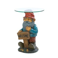 """Glass Top Garden #Gnome Welcome Sign 25"""" Tall Accent Side End Table / Plant #Stand  Give your guests a whimsical welcome into your home with this charming garden gnome accent table. The resin base features a tall gnome holding his homemade welcome sign and is capped with a circular glass tabletop. He's a great way to decorate your living space with a smile. #eBay!"""