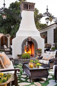 Mediterranean Patio with Raised beds, French doors, outdoor pizza oven, exterior stone floors