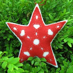 """This is for a reverse applique felt stuffed star, but you could make this with 2 die cut paper stars (one slightly larger than the other) and some """"anywhere"""" punches.."""
