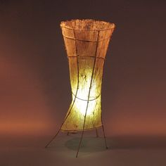 VORTEX FLOOR LAMP Materials: Hand Made Paper And Bamboo Dimensions: 20