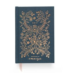 """5.25"""" x 7.75"""", 12 Month weekly + monthly calendar pages, book cloth cover, illustrated endpapers, inspirational quotes, January through December 2017, pocket folder, sections for celebrations, notes,"""