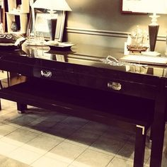 Beautifully detailed brown lacquer large format table and two matching benches. -