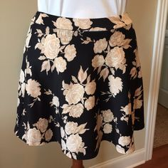 """FOREVER 21  A-LINE STRETCH FLORAL SKIRT. This is a flirty little number!  Because if it's stretch material resists wrinkles.  Great for a quick change, travel, anytime!  Always looks great.  Pull on styling.    This skirt measures approximately 16.5"""" long, from top of skirt to bottom. Forever 21 Skirts Mini"""