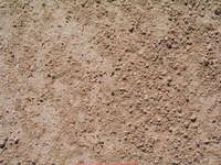 dry earth fine stones layer texture