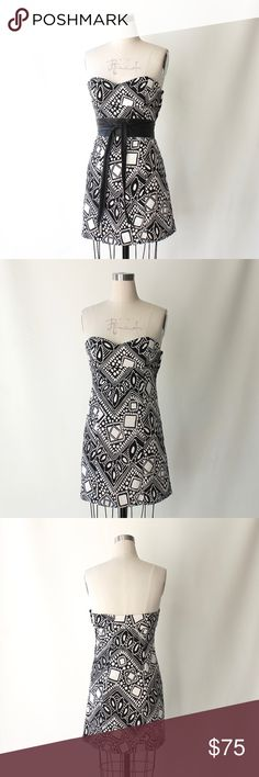 """Tibi Linen & Silk Printed Strapless Mini Dress Tibi black and white linen-silk blend strapless dress shaped with princess seams and boning. Interior elastic bra strap closure. Side zip closure. Lined interior. Thick, ribbed fabric similar to grosgrain. No signs of wear.  65% Linen  30% Silk 5% Spandex  Size 2  length 27"""" bust 32"""" - 33"""" waist 30"""" hip 37""""  *belts not included Tibi Dresses Strapless"""