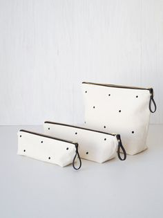 Polka dot makeup pouches. Modern Black & white lined zipper pouches. Cosmetic bags. Pencil cases. Brush holders. Women fashion accessories. Etsy Handmade. Cute gift idea