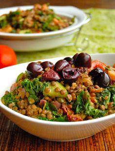 Greek Goddess Bowl. Brown rice, lentils,  kale, tomatoes, cucumber, Kalamata olives, onion, capers, with a lemon tahini dressing. Vegan.