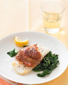 Dress up cod by wrapping each fillet in a slice of prosciutto, rubbing with olive oil, and broiling. Serve with sauteed spinach splashed with lemon juice. This elegant company dish is ready in just 25 minutes.