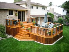 Creating a wooden deck in the backyard of the house provides various pleasure. First, it feeds the eyes with beauty. Second, we can use them for comfortable relaxing in free-time and it also balances the rough surface of the garden for us. The use of small pots at the stayers seems perfect in this backyard idea.