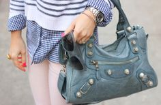 I may never own an authentic Balenciaga... but I will get my self a copy cat leather mirror version of this purse! lol