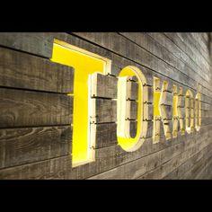Back Bar Wall Signage for Watermark. Tokkad | index-design.ca