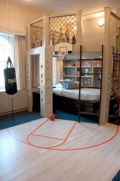 Brilliant Basketball Bunk Bed! This built-in is amazing, with a small loft playing (or sleeping?) above. Too cool.