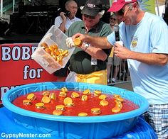 Unique Indeed! Bobbing for Burgers at the Hamburger Festival in Akron Ohio ... yup that's KETCHUP! See more: http://www.gypsynester.com/hamburger-festival.htm #festivals #travel #food