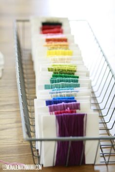 embroidery thread adds color and stays neat in a narrow wire basket