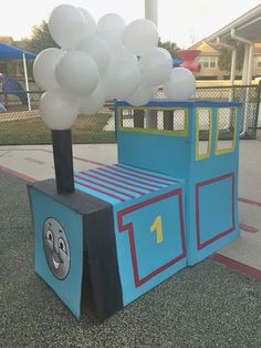 Create a unique photo booth for your upcoming Train themed party , using  nothing but a few large boxes, some tape, paint, some balloons, a...